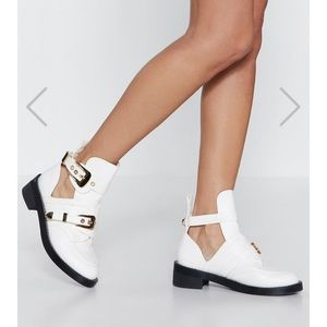White cutout boots with gold hardware